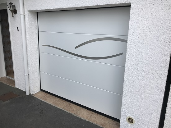 Installation d 39 une porte de garage sectionnelle sur salom - Installation porte de garage sectionnelle ...